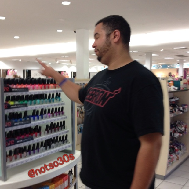 Here he is... Blocking the nail polishes and making me walk straight to the register...